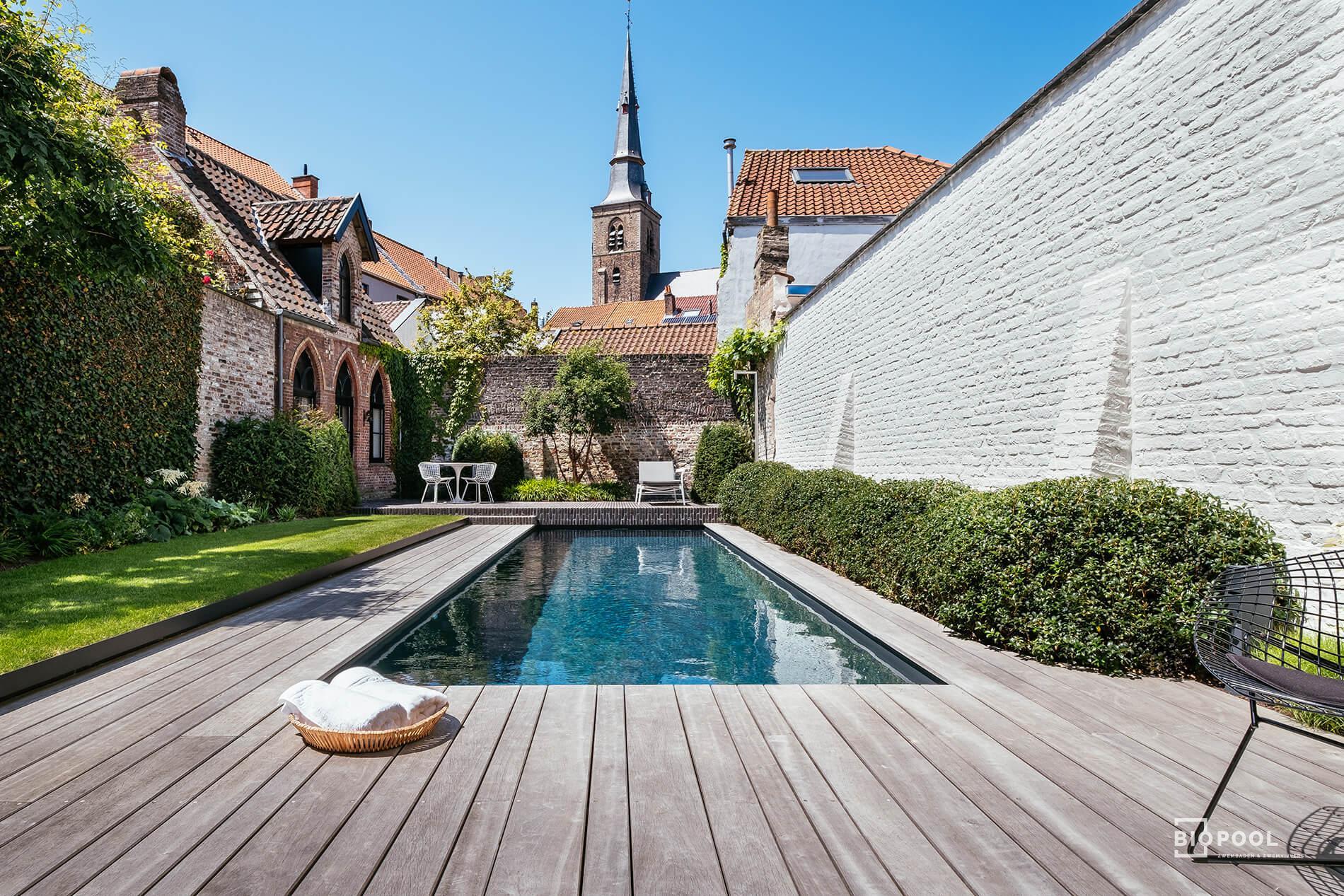 Afbeelding project PPC | High Line zwembad | Houten terras | tegenstroom | onder kerktoren | Brugge